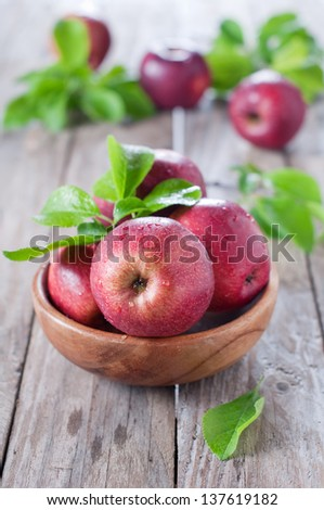 Red sweet apple on the table, selective focus - stock photo