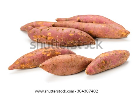 red sweet potatoes on the white background.