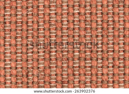 Red synthetic woven carpet closeup for texture or background - stock photo