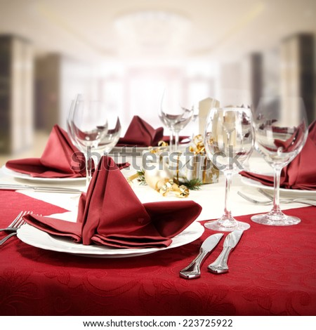 red table of food and glasses  - stock photo