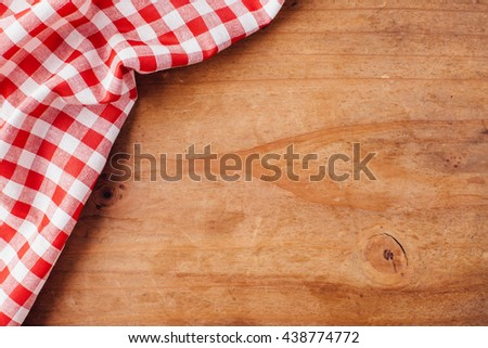red tablecloth on wooden background,crumpled fabric on wooden background - stock photo