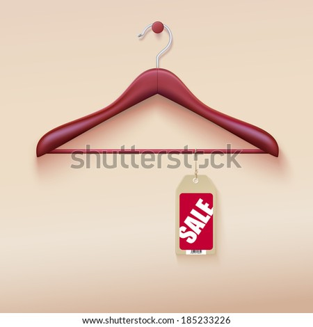 Red tag with sale sign hanging on wooden hanger - stock photo