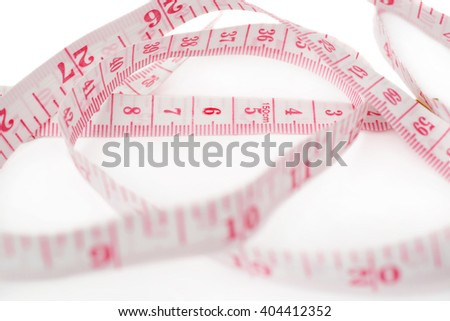 Red Tailor measuring tape isolated over the white background - stock photo