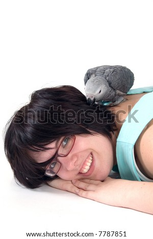 red tale baby parrot laying on womans back - stock photo