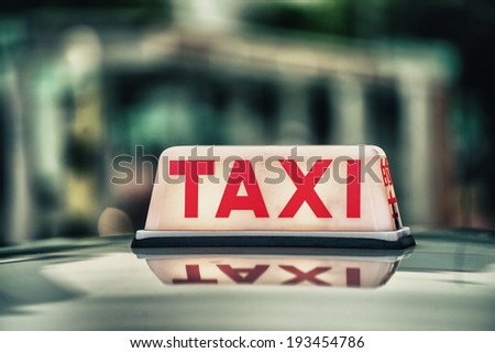Red Taxi Sign. - stock photo