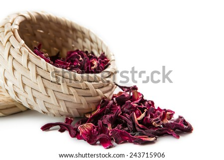 red tea in the wicker basket, Isolated on White Background. - stock photo