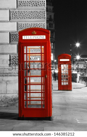 Red Telephone Booth at night. Red phone booth is one of the most famous London icons.  - stock photo