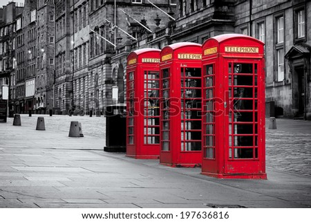 Red telephone booths along the famous royal mile in black and white in Edinburgh, capital of Scotland, United Kingdom - stock photo