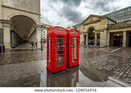 Red Telephone Box at Covent Garden Market on Rainy Day, London, United Kingdom - stock photo