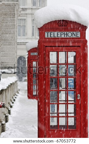 Red telephone box in snow