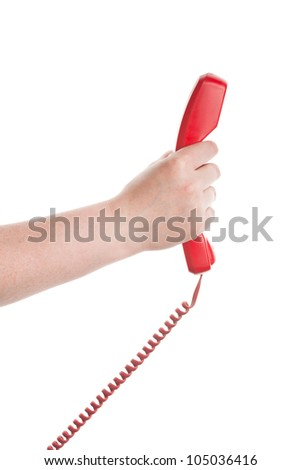 Red telephone receiver in hand isolated on white background - stock photo