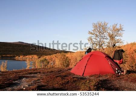 red tent in the wilderness of Sweden - Kungsleden - stock photo