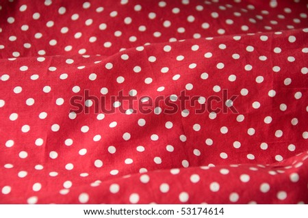 Red textile with white dots