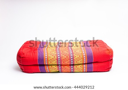 Red thai Pillow old used on white background. - stock photo