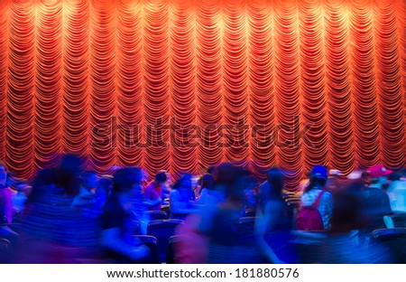 Red theatre curtain after the show end with crowd moving out - stock photo