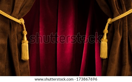 Red theatre curtains and yellow tassels - stock photo