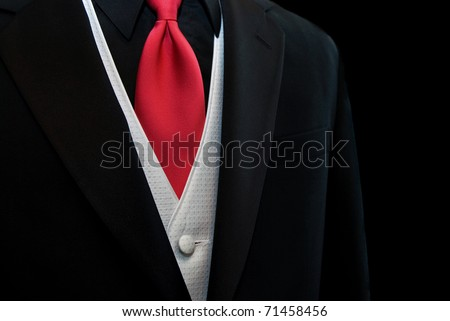red tie accenting a black tuxedo - stock photo