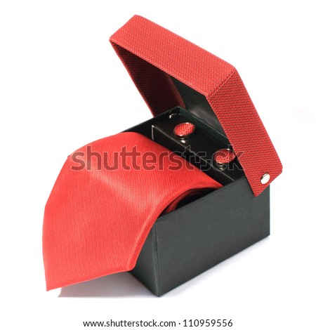 red tie in open box - stock photo
