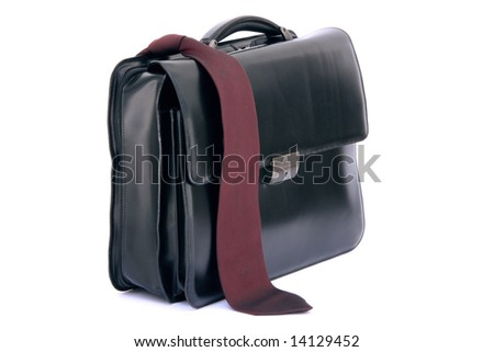 red tie on black leather business briefcase isolated on white background