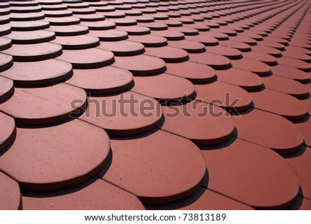 Red tiles of a newly built house - stock photo