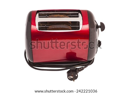Red toaster and two slices of bread isolated on white  - stock photo