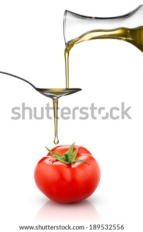 red tomato and pouring oil isolated on white - stock photo