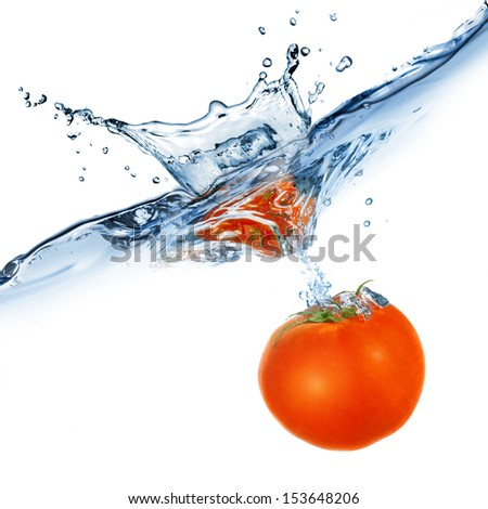 red tomato dropped into water isolated on white - stock photo