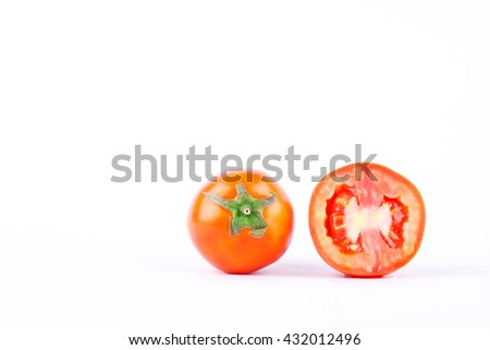 Red tomato is high in vitamin C vegetables fruit on the white background isolated  - stock photo