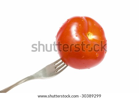 Red tomato on the stainless fork isolated - stock photo