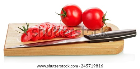 Red tomato slices on cutting board isolated on white background - stock photo