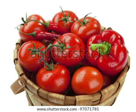 Red tomatoes and peppers in a basket