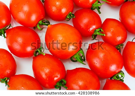 Red Tomatoes Isolated on a White Background Studio Photo