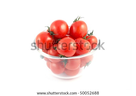 Red tomatoes on a plate isolated on white background - stock photo