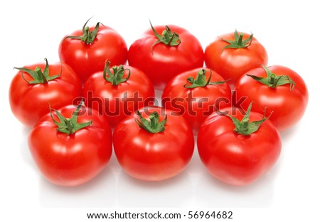 Red tomatoes on a white background, it is isolated.