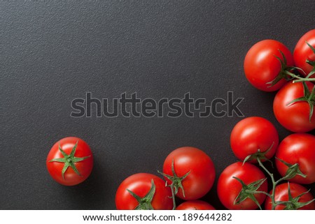 red tomatoes on black. top view - stock photo