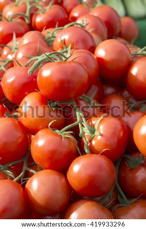 Red Tomatoes on Market Stall