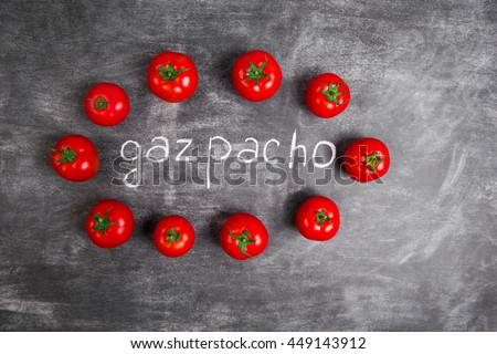 Red tomatoes on wooden grey table - stock photo