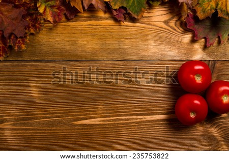 red tomatoes on wooden table - stock photo