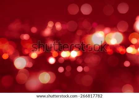 Red tone blur bokeh light. Defocused  background. - stock photo