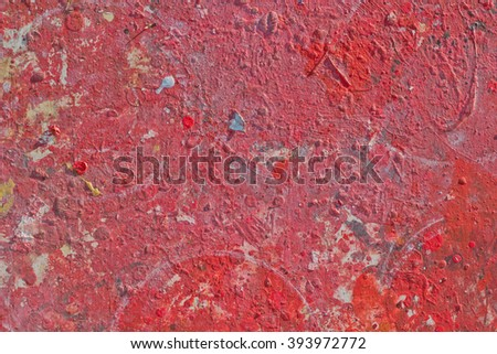 Red tones Abstract colorful texture background. Splash acrylic color on wood door. - stock photo