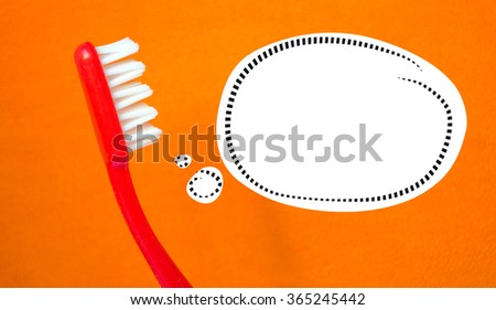 Red toothbrush and a bubble talk and orange background - stock photo