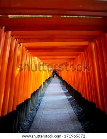 Red Tori Gate at Fushimi Inari Shrine in Kyoto, Japan - stock photo