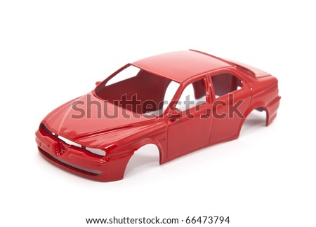 Red toy car body on white background - stock photo