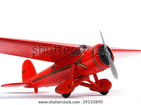 Red toy plane. close up on white background