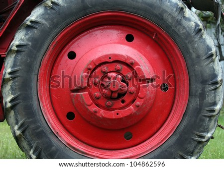 Red tractor wheel - stock photo