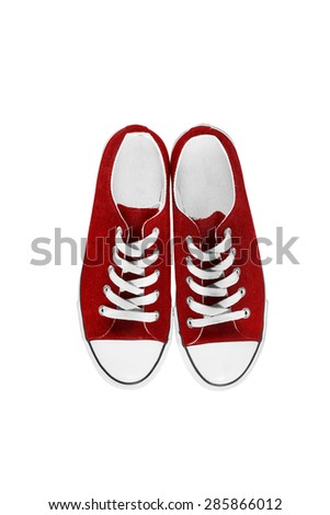 Red traditional gumshoes isolated over white - stock photo