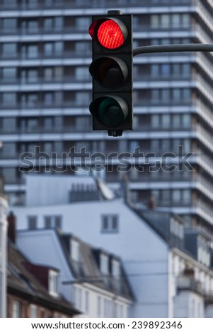 Red traffic light, in the background modern apartment buildings in Hamburg, Germany - stock photo