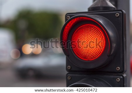 Red traffic light in the city street - stock photo