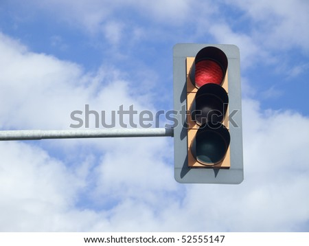 Red traffic light on sky - stock photo