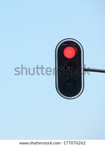 Red traffic lights against blue sky backgrounds - stock photo
